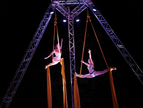 Aerial tissue and acrobats at street theatre festival in palace garden